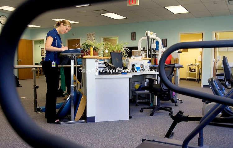 MIDDLEBURY CT. 08 May 2015-050815SV01-Kristen Davis, DPT, catches up on paperwork at Access Rehab at Middlebury Edge in Middlebury Friday.<br /> Steven Valenti Republican-American