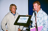 Wayne 'Rabbit' Bartholomew (AUS) presents Mark 'Occy' Occhilupo (AUS) with the 1996 Australian Surfing Hall of Fame Honour Roll Award for Surfing at the awards night held in Torquay, Victoria, Australia. Photo: joliphotos.com