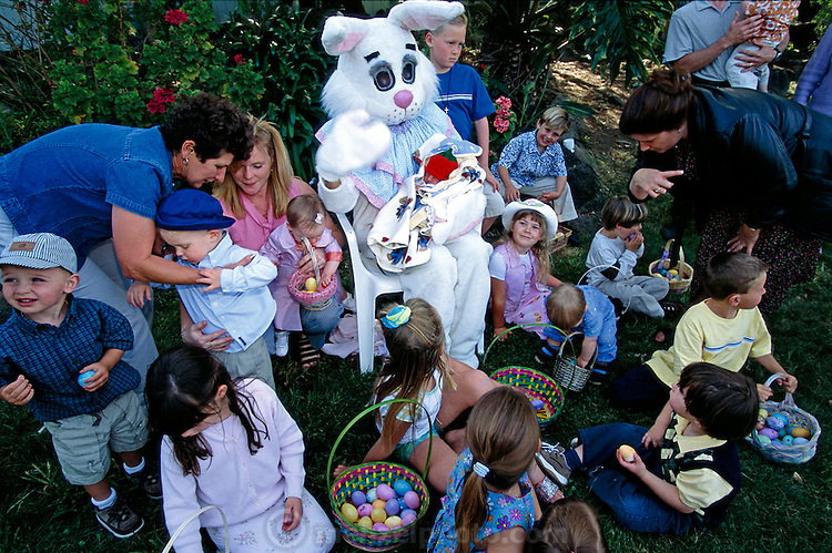 The next day, Easter Sunday, both Caven kids (Andrea, foreground, in pink; Ryan, foreground, holding egg) join Craig's family in Santa Rosa, 45 minutes away from their home in American Canyon, California, for their annual Easter egg hunt, complete with a man in an Easter Bunny suit. Hungry Planet: What the World Eats (p. 264).