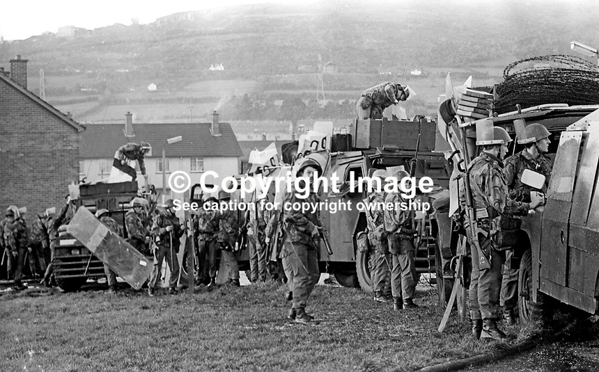 British soldiers relax during a lull in rioting in the Lenadoon housing estate, West Belfast, N Ireland. The outbreak of violence was caused by the alleged attempted take-over by Roman Catholics of nearby public housing traditionally occupied by Protestants. 9th July 1972. 197207090379f<br /> <br /> Copyright Image from Victor Patterson, 54 Dorchester Park, Belfast, UK, BT9 6RJ<br /> <br /> t: +44 28 9066 1296<br /> m: +44 7802 353836<br /> <br /> e1: victorpatterson@me.com<br /> e2: victorpatterson@gmail.com<br /> <br /> IMPORTANT: My Terms and Conditions of Business are at www.victorpatterson.com