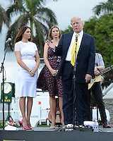 PALM BEACH, FL - JANUARY 05: Donald Trump, Ivanka Trump and Melania Trump attend the 2014 Trump Invitational Grand Prix at Club Mar-a-Lago on January 5, 2014 in Palm Beach, Florida. Credit: mpi04/MediaPunch
