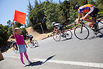 Delaney Rasmussen,7, raises the red flag at the third annual Foothill College Circuit Race at Foothill College July 14. Delaney's mom is a member of the Los Gatos Bicycle Racing Club, which helps organize the event.