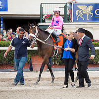 HALLANDALE BEACH, FL - MARCH 04:  Miss Sky Warrior, Paco Lopez up  being lead to the winners circle after winning the Davona Dale (G2) at Gulfstream Park, Hallandale Beach, FL. (Photo by Arron Haggart/Eclipse Sportswire/Getty Images)