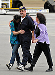 17 April 2009: Captain Richard Phillips walks upon US soil for the first time and is greeted by family members after completing an 18-hour journey home from Mombasa, Kenya, arriving at the Burlington International Airport, in Burlington, Vermont, USA 17 April 2009. Phillips was held hostage for five days by Somali pirates in an attempted hijacking of the Maersk cargo ship Alabama. United States Navy Seal sharpshooters on the USS Bainbridge killed three pirates to free Captain Phillips in his dramatic rescue.