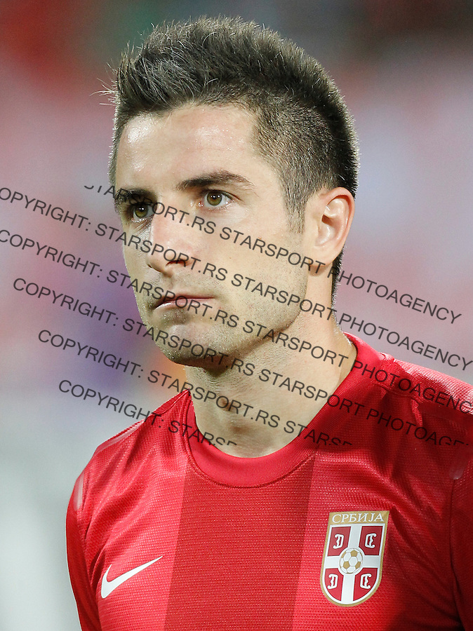 NOVI SAD, SERBIA - SEPTEMBER 11: Zoran Tosic of Serbia listen national anthem prior the FIFA 2014 World Cup Qualifier at stadium Karadjordje Park between Serbia and Wales on September 11, 2012 in Novi Sad, Serbia (Photo by Srdjan Stevanovic/Getty Images)