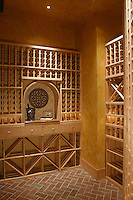 Classic Wine Cellar with herringbone brick tile flooring