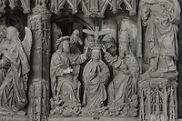 Mary kneels on a cloud and receives a crown from the Holy ghost, The Coronation of the Virgin, before 1540, from the choir screen, Chartres Cathedral, Eure-et-Loir, France. Chartres cathedral was built 1194-1250 and is a fine example of Gothic architecture. It was declared a UNESCO World Heritage Site in 1979. Picture by Manuel Cohen.