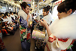 Kimono-clad 20-year-old Japanese women ride a train after a ceremony held for Coming-of-Age Day at Toshimaen amusement park in Tokyo, Japan. While Japanese women can marry as early as 16 years of age and men at 18, neither is considered to reach adulthood until they reach 20, when they can also legally begin to smoke, drink and vote.