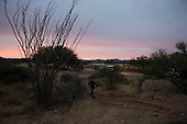 Three Points, Arizona.USA.October 23, 2006..The Minuteman Civil Defense Corps of Arizona and a US border patrolman search a field for illegal immigrates after catching four near the King Anvil Ranch which is close to the Mexican border.