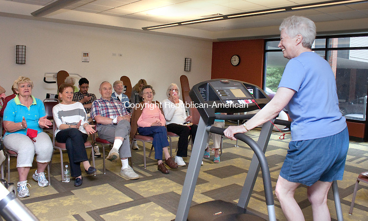 SOUTHBURY CT- MAY 14 2014 052814DA09- Resident, Ginny Middleton of Watermark at East Hill senior-living community finishes up her mile on a treadmill as her friends cheer her on during the annual triathlon in honor of National Senior Fitness Day on Wednesday. The event feature a variety of activities, such as swim, bike and walk for the seniors to take part in. Each event will be judged, and the winner will receive an award.  The common goal for this day is to help keep older Americans healthy and fit. Fitness Day is the nation's largest event for older adults.<br /> Darlene Douty Republican American