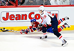 10 February 2010: Montreal Canadiens' diving right wing forward Brian Gionta is tripped up by Washington Capitals left wing forward Alexander Semin at the Bell Centre in Montreal, Quebec, Canada. The Canadiens defeated the Capitals 6-5 in sudden death overtime, ending Washington's team-record winning streak at 14 games. Mandatory Credit: Ed Wolfstein Photo
