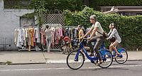 Street activity in the popular destination, the Williamsburg neighborhood of Brooklyn in New York on Sunday, August 3, 2014. © Richard B. Levine)