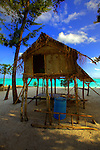 Fishermen's hut on pilotis at Panasia Island.Panasia is a spectacular island of uplifted coral reef making jagged limestone cliffs in the Louisiade Archipelago..The Louisiade Archipelago is a string of ten larger volcanic islands frequently fringed by coral reefs, and 90 smaller coral islands located 200 km southeast of New Guinea, stretching over more than 160 km and spread over an ocean area of 26,000 km  between the Solomon Sea to the north and the Coral Sea to the south. The aggregate land area of the islands is about 1,790 kmu178  (690 square miles), with Vanatinai (formerly Sudest or Tagula as named by European claimants on Western maps) being the largest..Sideia Island and Basilaki Island lie closest to New Guinea, while Misima, Vanatinai, and Rossel islands lie further east..The archipelago is divided into the Local Level Government (LLG) areas Louisiade Rural (western part, with Misima), and Yaleyamba (western part, with Rossell and Tagula islands. The LLG areas are part of Samarai-Murua District district of Milne Bay. The seat of the Louisiade Rural LLG is Bwagaoia on Misima Island, the population center of the archipelago. .The Louisiade Archipalego is part of the Milne Bay province of Papua New Guinea..It lies between approximately 10 degrees south and 11.5 degrees south, and 151 degrees east and 154 degrees east. It is an area of Islands, reefs and cays some 200 nm long and 50 nm wide, stretching from the south east tip of mainland Papua New Guinea in a east south east direction..Panasia Island.Panasia is a spectacular island of uplifted coral reef making jagged limestone cliffs in the the Louisiade Archipelago..The Louisiade Archipelago is a string of ten larger volcanic islands frequently fringed by coral reefs, and 90 smaller coral islands located 200 km southeast of New Guinea, stretching over more than 160 km and spread over an ocean area of 26,000 km  between the Solomon Sea to the north and the Coral Sea to the south. The aggregate land area of t