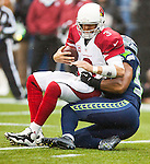 Seattle Seahawks linebacker Bobby Wagner (54) sacks Arizona Cardinals quarterback Carson Palmer (3) during the third quarter at CenturyLink Field in Seattle, Washington on December 22, 2013.    Palmer completed 13 of 25 passes for 178 yards, three four interceptions and one touchdown in the Cardinals 17-10 win over the Seahawks. ©2013. Jim Bryant Photo. ALL RIGHTS RESERVED.