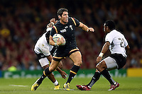 James Hook of Wales takes on the Fiji defence. Rugby World Cup Pool A match between Wales and Fiji on October 1, 2015 at the Millennium Stadium in Cardiff, Wales. Photo by: Patrick Khachfe / Onside Images