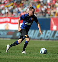 Manchester United midfielder Tom Cleverly (35) dribbles toward the goal.  Manchester United defeated the Chicago Fire 3-1 at Soldier Field in Chicago, IL on July 23, 2011.