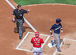 23 August 2015: MLB Umpire Rob Drake signals a home plate run scored by Scooter Gennett in the first inning of a game between the Milwaukee Brewers and the Washington Nationals at Nationals Park in Washington, DC. The Nationals defeated the Brewers 9-5 in the third game of their 3-game weekend series. Mandatory Credit: Ed Wolfstein Photo *** RAW (NEF) Image File Available ***