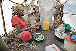 A woman and her daughter prepare food in their hut in a camp in rebel-held territory in the eastern Congo. Families displaced by fighting between rebel Tutsi General Laurent Nkunda and the Congolese military took refuge in this camp they established in the shadow of a United Nations base in the village of Kiwanja. According to aid workers and human rights groups, rebel soldiers executed some 150 people here in a 24-hour period in early November. The killings took place half a mile from the UN base, yet the 120 UN peacekeepers, part of the largest UN peacekeeping contingent in the world, did not take any action to stop the violence. ...