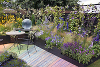 Rainbow walkway, vines, ornamental grasses, patio furniture, airy plantings, in purple, blues and yellow, with gazing ball, for exciting garden colors