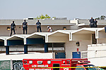 LAPD from the Wilshire division  and LA School Police attempt to subdue a man from killing himself on top of L.A. High School. The man would not follow orders given to him by the LAPD, who ended up shooting the man with non-lethal bean bags and a taser. The man was taken to the hospital after being hoisted off the roof by the LAFD.