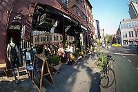 Diners dine al fresco in the Greenwich Village neighborhood of New York on Thursday, September, 13 2012. (© Frances M. Roberts)