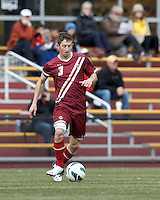Boston College defender Ryan Dunn (3) passes the ball. Boston College (maroon) defeated Virginia Tech (Virginia Polytechnic Institute and State University) (white), 3-1, at Newton Campus Field, on November 3, 2013.