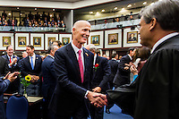 TALLAHASSEE, FLA. 1/12/16-Gov. Rick Scott, left, greets Florida Supreme Court Chief Justice Jorge Labarga, during the opening day of the 2016 legislative session, Tuesday at the Capitol in Tallahassee.<br /> <br /> COLIN HACKLEY PHOTO