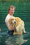 Carrying Golden Retriever Into Water