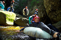 TSITSIKAMMA NATIONAL PARK, SOUTH AFRICA, DECEMBER 2004. Tubing down the Storms River Canyon. South African Nature offers some of the world's best adrenaline sports and outdoor challenges. Photo by Frits Meyst/Adventure4ever.com