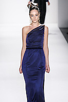 Model walks runway an by Zang Toi, for the Zang Toi Spring 2012 My Dream Of North Africa Collection, during Mercedes-Benz Fashion Week Spring 2012.