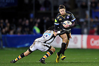 Matt Banahan of Bath Rugby is tackled by Ben Jacobs of Wasps. European Rugby Champions Cup match, between Bath Rugby and Wasps on December 19, 2015 at the Recreation Ground in Bath, England. Photo by: Patrick Khachfe / Onside Images