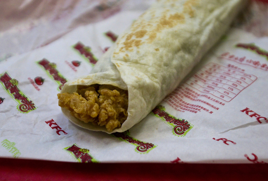 """An """"Old Beijing"""" style wrap with chicken and black bean sauce is served at a KFC in Chongqing."""