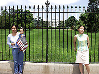 Two women and a baby pose for photos at the back of the White House, Washington, DC.