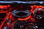 Bellmore, New York, USA. 12th June 2015. Under an open hood, the engine of a red 1972 Pontiac Convertible LeMans Sport is lit up in red at the Friday Night Car Show held at the Bellmore Long Island Railroad Station Parking Lot. Hundreds of classic, antique, and custom cars were on view at the free weekly show, sponsored by the Chamber of Commerce of the Bellmores.