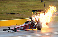 Sept. 22, 2012; Ennis, TX, USA: NHRA top fuel dragster driver Scott Palmer blows an engine on fire during qualifying for the Fall Nationals at the Texas Motorplex. Mandatory Credit: Mark J. Rebilas-US PRESSWIRE