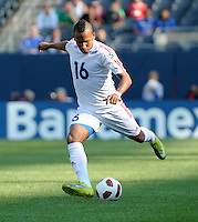 Cuba's Joel Colomé kicks the ball.  El Salvador defeated Cuba 6-1 at the 2011 CONCACAF Gold Cup at Soldier Field in Chicago, IL on June 12, 2011.