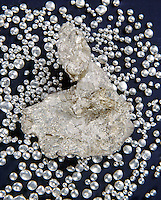 SILVER (Ag)<br /> Konigsbergite Leaf Silver &amp; Silver Shot.<br /> Silver is a chemical element (Ag). A soft white lustrous transition metal, it has the highest electrical and thermal conductivity of any metal and occurs in minerals and in free form. Used in coins, jewelry, tableware, photography, and in mirrors.