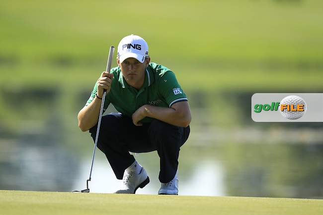 Tom Lewis (ENG) lines up his putt on the 16th green during Thursday's Round 1 of the 2013 BMW International Open held on the Eichenried Golf Club, Munich, Germany. 20th June 2013<br /> (Picture: Eoin Clarke www.golffile.ie)