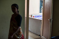 A lady walks into a the waiting room outside the operation theater of Dr. Nayana Patel's Akanksha clinic  in Anand, Gujarat, India on 11th December 2012. Photo by Suzanne Lee / Marie-Claire France