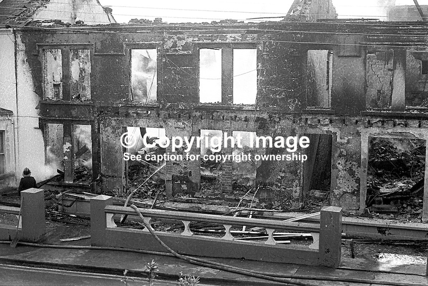 Firemen were still at the Royal Hotel, Whitehead, the morning after its owner, Larry McMahon, Newtownabbey, Co Antrim, married, 4 children, Roman Catholic, was murdered at his Newtownabbey home. He was murdered by the UVF, Ulster Volunteer Force, a loyalist paramilitary organization, on 15th March 1973. An explosive device detonated killing him instantly when he went to investigate a noise at his front door at 21.45. His wife and some of his children were also injured. Mr McMahon's success was a rags to riches story. He started off as a barman and ended up owning the Royal Hotel in Whitehead and a chain of betting shops as well as three pubs. 197303150134e<br />