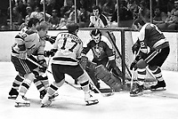 Seals vs Penguins...1968-69: Seals Stan Gilbertson, Norm Ferguson try to jam puck past, Penguin goalie Jim Rutherford and #2 Duane Rupp..(photo/Ron Riesterer)
