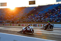 Jul 8, 2016; Joliet, IL, USA; NHRA pro stock motorcycle rider Steve Johnson (near) races alongside Chip Ellis during qualifying for the Route 66 Nationals at Route 66 Raceway. Mandatory Credit: Mark J. Rebilas-USA TODAY Sports