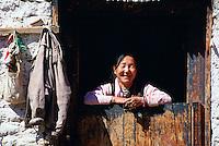 Woman at doorway, Paro, Bhutan