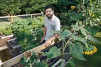 NWA Democrat-Gazette/DAVID GOTTSCHALK  Elliott James stands Wednesday, July 20, 2016, in his favorite personal space, the garden in the backyard of his home in Fayetteville.