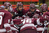 Colgate gathers around their net prior to the game. - The Harvard University Crimson defeated the visiting Colgate University Raiders 6-2 (2 EN) on Friday, January 28, 2011, at Bright Hockey Center in Cambridge, Massachusetts.