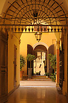 An archway looking into a small courtyard in Bologna, Italy.