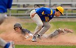 TORRINGTON, CT-042017JS06- Wolcott Tech's Mitchell Sorenson (5) slides safely into third under the tag by Harding's Rafael Carrero (13) during their game Wednesday at Fuessenich Park in Torrington. <br /> Jim Shannon Republican-American