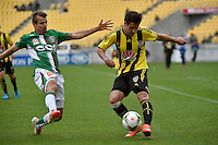 Thomas Doyle and Joel Griffiths in action during the A League - Wellington Phoenix v Newcastle Jets Game at Westpac Stadium, Wellington, New Zealand on Sunday 26 October 2014. <br /> Photo by Masanori Udagawa. <br /> www.photowellington.photoshelter.com.
