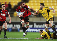 Jeremy Thrush tries to scrag Kieran Read. Super 15 rugby match - Crusaders v Hurricanes at Westpac Stadium, Wellington, New Zealand on Saturday, 18 June 2011. Photo: Dave Lintott / lintottphoto.co.nz