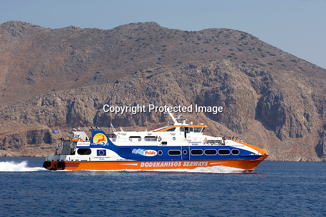 Dodekanisos Seaways boat leaving the harbor at Simi, Greece